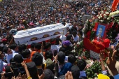 The coffin of Nyi Nyi Aung Htet Naing, who died from a gunshot wound while attending a demonstration against the military coup, is carried during his funeral service in Yangon [AFP]