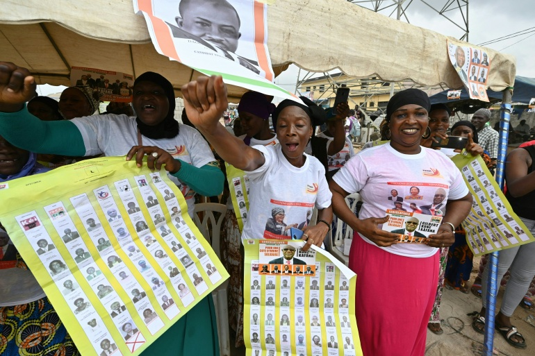 Women take part in Ivory Coast's parliamentary election campaign rally in the popular district of Yopougon, a suburb in Abidjan [File: Issouf Sanogo/AFP]