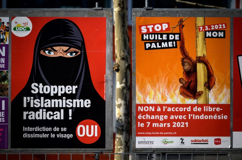Swiss voters approve burqa ban in tight referendum