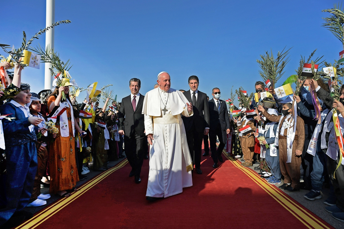 Upon his arrival in Erbil, the capital of the autonomous Kurdistan region, Pope Francis is flanked by regional President Nechirvan Barzani, right, and Prime Minister Masrour Barzani, left. [Handout/Vatican Media via AFP]