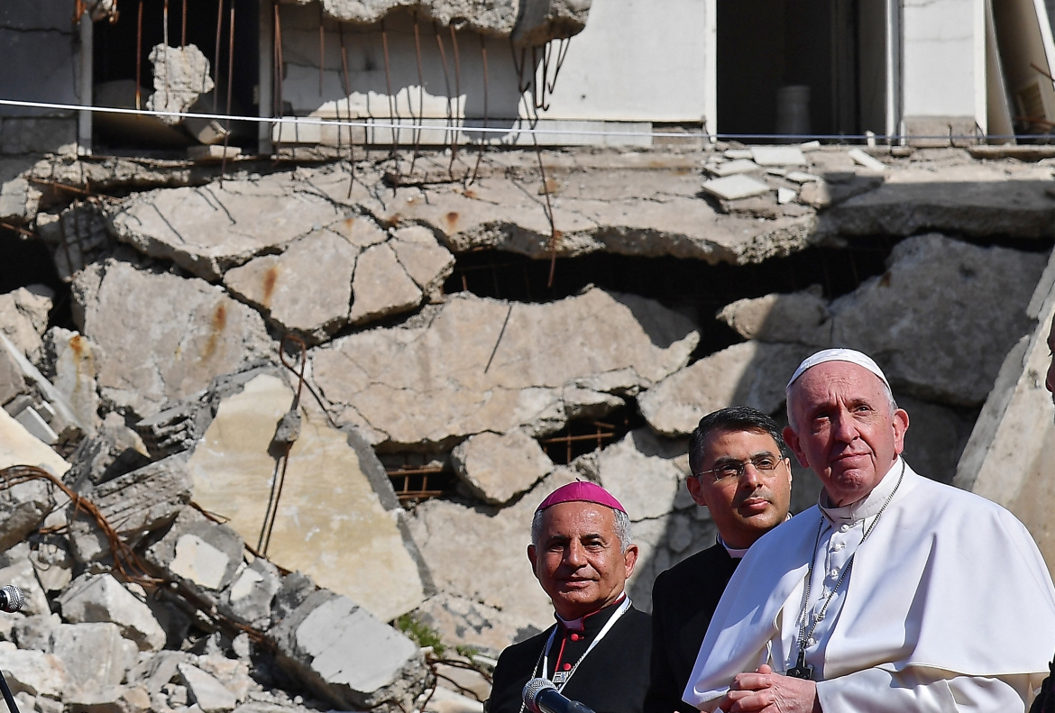 Accompanied by the Chaldean Catholic Archbishop of Mosul, Najib Mikhael Moussa, left, Pope Francis looks over a square near the ruins of the Syriac Catholic Church of the Immaculate Conception (al-Tahira-l-Kubra), in Mosul. [Vincenzo Pinto/AFP]