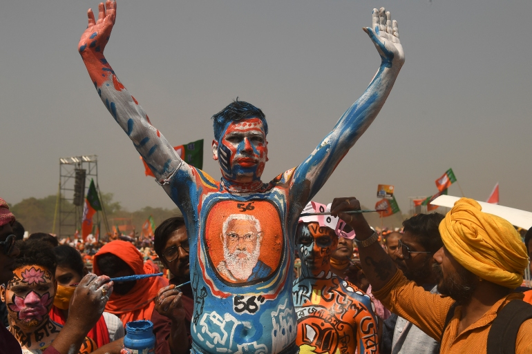 A BJP supporter with his body painted gestures during an election rally addressed by India's Prime Minister Narendra Modi in Kolkata [Dibyangshu Sarkar/AFP]
