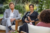 Prince Harry and his wife Meghan Markle in a conversation with US television host Oprah Winfrey. The couple's interview with Winfrey was broadcast late on Sunday in the US [Joe Pugliese/Harpo Productions via AFP]
