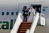 Pope Francis gestures as he bids farewell to his Iraqi hosts [AFP]
