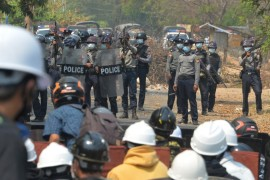 Riot police hold their firearms as they face-off with protesters in the capital, Naypyidaw on Monday [Stringer/AFP]