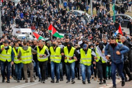 Palestinian citizens of Israel march during a demonstration in the city of Umm al-Fahm on March 12 against organised crime and what they view as Israeli police complicity [File: Ahmad Gharabli/AFP]