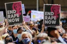 Protesters attend a rally against sexual violence and gender inequality in Sydney on March 15, 2021 [Steven Saphore/ AFP]