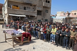 Syrian mourners pray during a funeral in the the village of Atareb in the northern Syrian province of Aleppo [Aaref Watad/AFP]