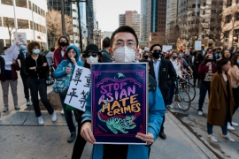 People march in downtown Montreal, Canada during a demonstration against anti-Asian racism on March 21, 2021 [Andrej Ivanov/AFP]
