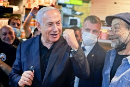 Israel's longest-serving prime minister has a slight lead in opinion polls but Tuesday's outcome remains unpredictable [Menahem Kahana/AFP]