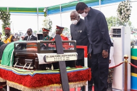 Zambia's President Edgar Lungu, right, pays his last respects at the coffin of Magufuli [AFP]