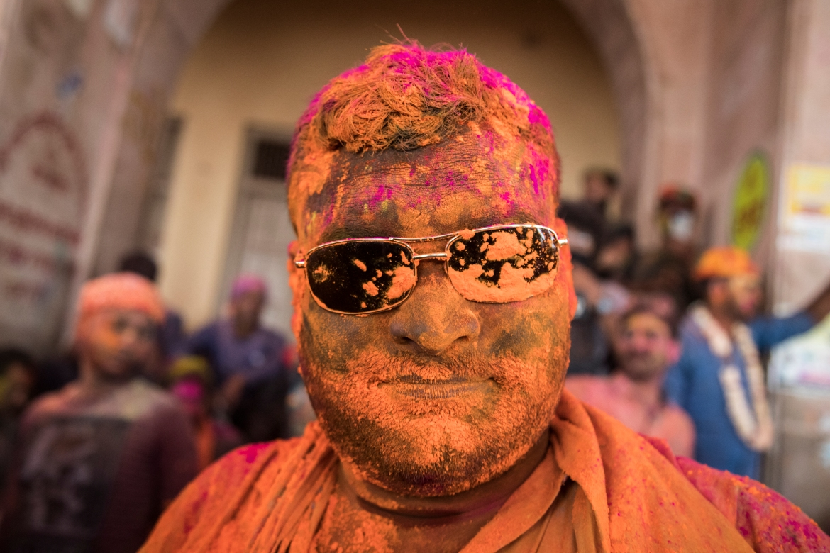 A Hindu devotee takes part in a traditional gathering during the Lathmar Holi celebrations, the spring festival of colours at a temple in Barsana village in Mathura. [Xavier Galiana/AFP]