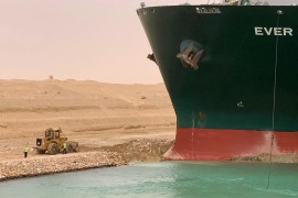 A large container ship container ship registered in Panama ran aground in the Suez Canal on 23 March, blocking passage of other ships and causing a traffic jam for cargo vessels [AFP]