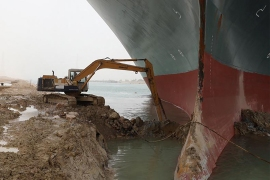 The 59-metre wide vessel is lodged sideways and impeding all traffic across the waterway of Egypt's Suez Canal [AFP]