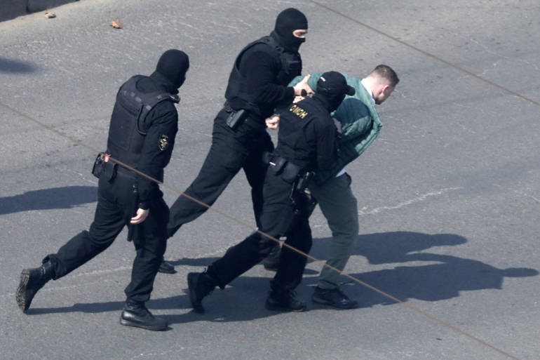 Belarus law enforcement officers detain a man at a planned rally after protesters were prevented from doing so by police, who cordoned off several streets, at a main square and park in Minsk [AFP]