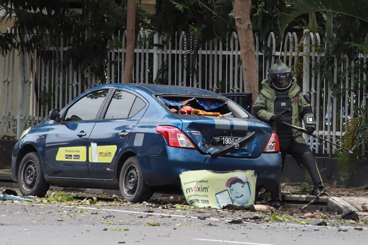 An Indonesian anti-bomb unit collects evidence after the explosion in Makassar. [Irvan Abdullah/AFP]