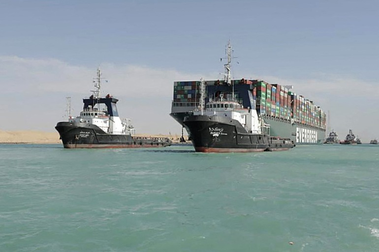 Ever Given, one of the world's largest container ships, is seen after it was fully floated in the Suez Canal on Monday [Handout/Suez Canal Authority via AFP]