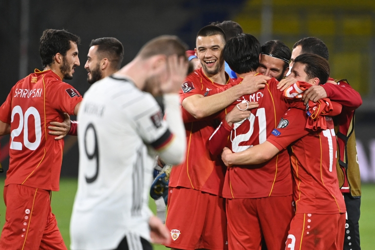 North Macedonia players celebrate after beating Germany [Ina Fassbender/AFP]