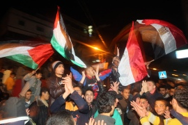 Palestinians wave the Palestinian and Egyptian flags, as they celebrate in Gaza on February 11, 2011 following news that Egyptian President Hosni Mubarak had stepped down [File: AFP/ Mahmud Hams]