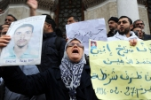 Family members of victims who disappeared during the war in Algeria in the 1990s shout slogans as they take part in a demonstration on March 15, 2014 calling for justice [File: Farouk Batiche/AFP]