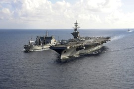The aircraft carrier USS Theodore Roosevelt (CVN 71) pulls alongside the Indian Deepak-class fleet tanker INS Shakti (A 57) during a military exercise between the US and India [File: US Navy Handout Photo/AFP]