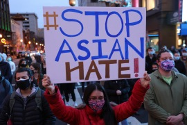 Activists in Washington, DC participate in a vigil in response to the Atlanta spa shootings - in which six of the eight victims were women of Asian descent [Alex Wong/ Getty Images/ AFP]