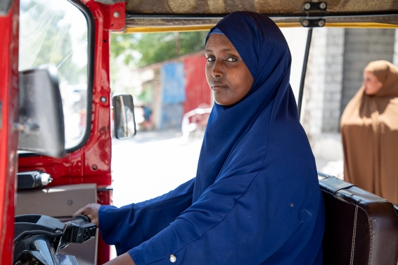 Saynab has been driving tricycles on the streets of Mogadishu for 11 months [Noor Mohamed/Al Jazeera]