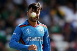 Within six years, Khan's name is first on every Afghanistan team sheet [Lee Smith/Reuters]