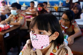 Indonesia's national motto is 'unity in diversity' but schoolgirls across the archipelago told a rights group they felt bullied into confirming with Islamic dress codes in the classroom [File: Ajeng Dinar Ulfiana/Reuters]