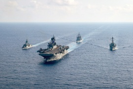 The US Navy and the Royal Australian Navy patrol together in the South China Sea [File: Reuters]