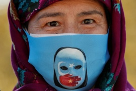 An ethnic Uighur demonstrator wearing a protective face mask takes part in a protest against China, in Istanbul, Turkey, on October 1, 2020 [File: Murad Sezer/ Reuters]