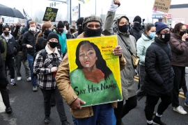 Kent Ford, co-founder of Portland's Black Panther Party, carries a painting of Breonna Taylor during a Black Lives Matter march on December 6, 2020 [File: Alisha Jucevic/Reuters]