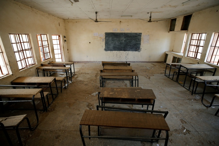 A view of an empty classroom at the school in Dapchi in the northeastern state of Yobe, Nigeria, where dozens of schoolgirls went missing after an attack on the village by Boko Haram on February 23, 2018 [File: Afolabi Sotunde/AFP]