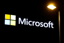While Microsoft released a patch last week to shore up flaws in its email software, the remedy still leaves open a so-called back door that can allow access to compromised servers [File: Arnd Wiegmann/Reuters]