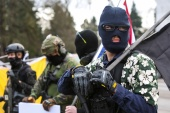 "An armed group, who identify as ""Liberty Boys"" and the anti-government group ""Boogaloo Bois"" protest outside the Oregon State Capitol, as they advocate for less government control, in Salem, Oregon, U.S., January 17, 2021. REUTERS/Alisha Jucevic"