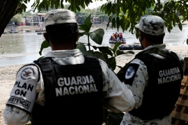 Members of the Mexican National Guard guarding the Suchiate River, the natural border between Mexico and Guatemala [File: Carlos Jasso/Reuters]