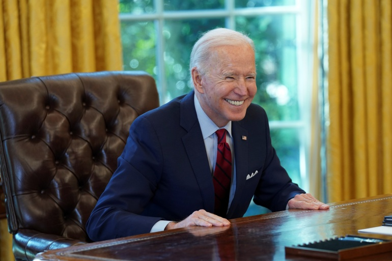 US President Joe Biden has signed more than 50 executive actions since taking office [File: Reuters/Kevin Lamarque]