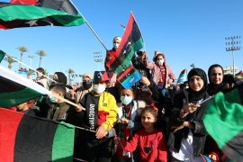 People wave Libyan flags as they gather during celebrations commemorating the 10th anniversary of the 2011 revolution in Tripoli, Libya February 17, 2021 (REUTERS/Hazem Ahmed) (Reuters)