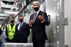 US President Joe Biden tours a Pfizer manufacturing plant producing the coronavirus vaccine in Kalamazoo, Michigan [File: Tom Brenner
