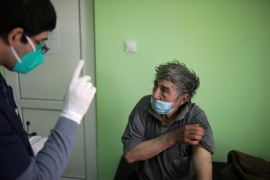 A man looks on after receiving a dose of AstraZeneca's vaccine in the village of Ognen, Bulgaria [Stoyan Nenov/Reuters]