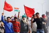 Farmers shout slogans as they take part in a three-hour 'chakka jam' or road blockade, as part of protests against farm laws on a highway on the outskirts of New Delhi [File: Adnan Abidi/Reuters]
