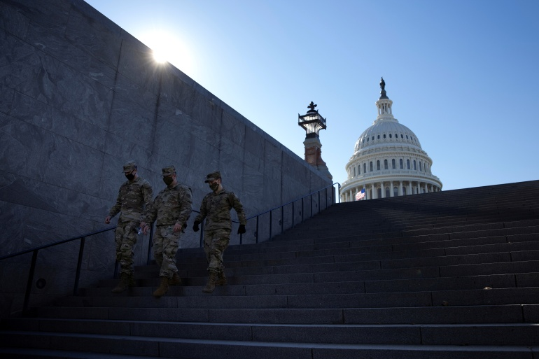 The United States Senate cleared the way for passage of a $19 trillion COVID-19 relief package amid tight security in Washington, DC [Tom Brenner/Reuters]