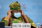 New Director-General of the World Trade Organisation Ngozi Okonjo-Iweala says dialogue on a proposal to waive patents for the duration of the coronavirus pandemic was 'intensifying' [Fabrice Coffrini/Pool via Reuters]