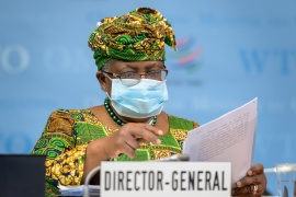 New Director-General of the World Trade Organisation Ngozi Okonjo-Iweala says dialogue on a proposal to waive patents on COVID vaccines for the duration of the coronavirus pandemic was 'intensifying' [Fabrice Coffrini/Pool via Reuters]