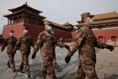 Paramilitary police officers walk in formation outside the Forbidden City near the venue of the upcoming National People's Congress (NPC) in Beijing [Thomas Peter/Reuters]