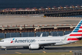 American Airlines flight 718, the first US Boeing 737 MAX commercial flight since regulators lifted a 20-month grounding in November, lands at LaGuardia airport in New York on December 29, 2020 [File: Eduardo Munoz/Reuters]