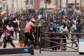 Supporters of opposition leader Ousmane Sonko clash with security forces in Dakar on Friday [Zohra Bensemra/Reuters]