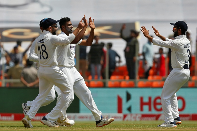Ashwin celebrates with captain Kohli and Rahane after taking the wicket of Bairstow [Amit Dave/Reuters]