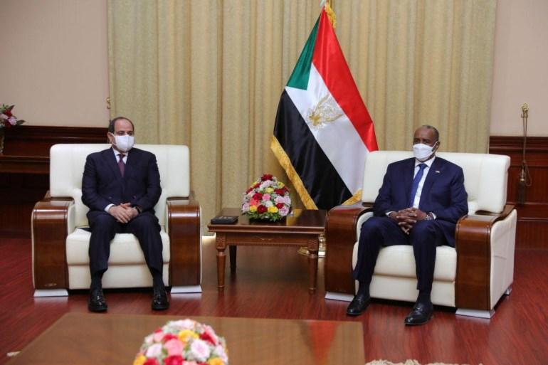 Sudan's Sovereign Council chief General Abdel Fattah al-Burhan meets Egyptian President Abdel Fatah el-Sisi in Khartoum [Sudan Sovereign Council/Handout via Reuters]