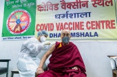 Tibetan spiritual leader, the Dalai Lama, receives a dose of coronavirus disease (COVID-19) vaccine at a vaccination centre in Dharamsala, India [Office of his holiness the Dalai Lama Handout via Reuters]